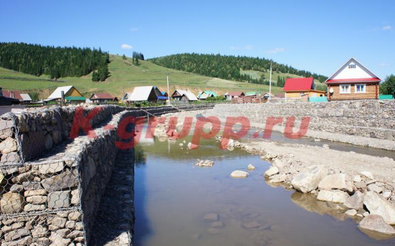 Укрепление берегов пруда природным камнем от К-групп фото
